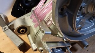 Carburettor overflow hoses bracket